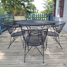 Mesh Patio Table Wrought Iron Mesh Patio Table And Four Chairs Ebth