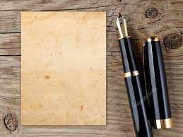 old writing paper fountain pen and vintage paper on old wooden background stock fountain pen and vintage paper on old wooden background stock photo 18975333
