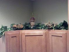 ideas for decorating above cabinets between 3 sistersbetween 3