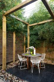 great wooden fence for perfect small private patio ideas