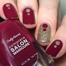 solid with red and rhinestones stilleto nails the red is