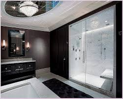 bathroom bathroom with chandelier and black cabinet with white