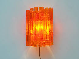 large orange wall light by claus bolby for cebo industri for sale