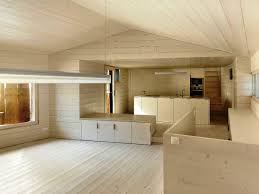 cream wall native wood house design with wooden cabinet on the cream wall native wood house design with wooden cabinet on the wooden floor with small windows ideas