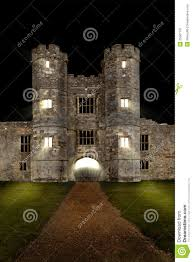 old castle at night with lights and draw bridge stock image