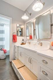 cottage kids bathroom with built in pull out step stools cottage