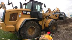 the new cat 938k in wet clay youtube