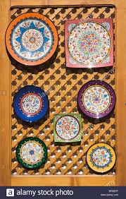 brightly coloured ceramic souvenir plates for sale outside shop in