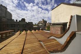 roll up rooftop daring rounded wood deck design in nyc