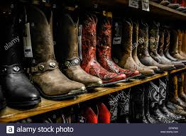 motorcycle boots store multiple shelves of unique cowboy boots on display at downtown