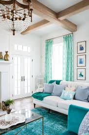 turquoise and white living room with shiplap walls lovely living