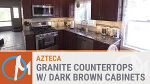 kitchen with brown cabinets azteca granite counters with dark brown cabinets youtube
