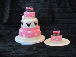 minnie mouse 3 tier b day cake with one for the child 1st birthday
