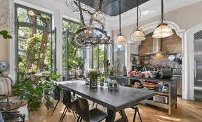 French Doors Dining Room by A Steel Chandelier And French Doors To A Garden Patio In This