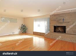 large empty living room stone fireplace stock photo 69227386