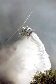 Wildfire Near Markleeville Ca by A Los Angeles County Fire Department Helicopter Makes A Drop On A