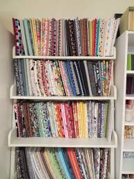 using comic book boards to neatly organize fabric on shelves