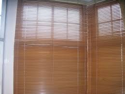 set of three john lewis oak venetian blinds suitable for bay