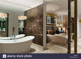 Freestanding Bathroom Furniture Uk by Freestanding Ensuite Bathtub With Marble Partition Wall To Double