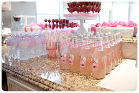 pink baby shower individual pink lemonades and water bottles decked out with labels