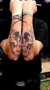 matching skull tattoos design on forearms skull forearm