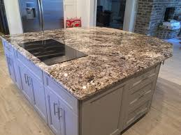 white tiger granite caps the oversized kitchen island emrichpro com