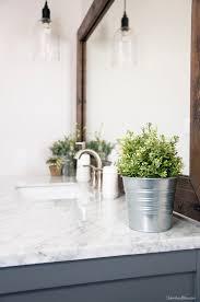 36 best farmhouse bathroom design and decor ideas for 2017 metal bucket flower planter bathroom decorations
