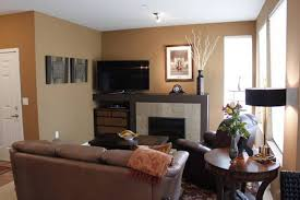 condo living room design with earthy brown wall color and