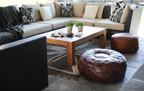 black outdoor sectional with black ikat pillows transitional
