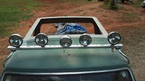 light bar and lights mounted and a whole in the roof the