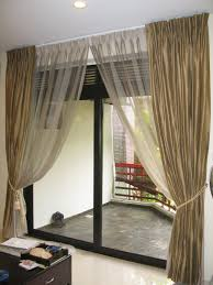 golden fabric curtains on hook connected by vitrage