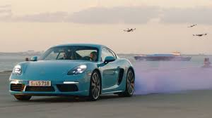 porsche cayman green watch the porsche 718 cayman s race a swarm of drones the drive