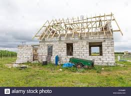 unfinished house in countryside building a house in european stock photo unfinished house in countryside building a house in european village in poland small family house at construction