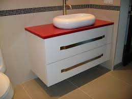 bathroom white bathroom vanity with red countertop and sink for