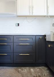 what hardware looks best on black cabinets kitchen update painted cabinets brittanymakes this