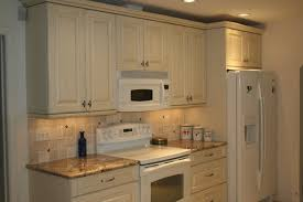 antique white cabinets with white appliances for the home