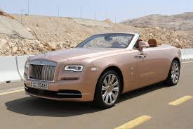 rolls royce sports car dawn in the desert driving a rolls royce in abu dhabi