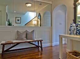 Half Wall Table Delightful Foyer Space With Mirrored Walls And Wainscoting Half