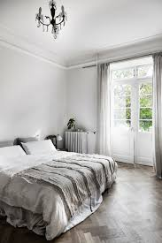 Light Gray Curtains by A Beautiful And Simple Grey Bedroom With Grey Bedding Light Grey
