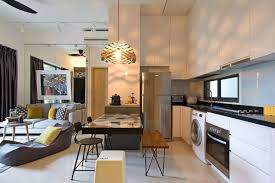 adaptable apartment celebrates whimsical touches and exciting art view in gallery cantilevered dining table that is a part of the larger kitchen design