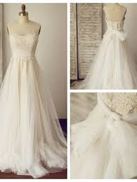 Modern Vintage Inspired Wedding Dresses Lb Studio By Cocomelody Latest A Line V Neck Natural Chapel Train Tulle And Lace Ivory