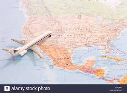 The Map Of United States Of America by Miniature Of A Passenger Airplane Flying On The Map Of United