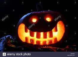 halloween pumpkin lantern at night with moonlight stock photo