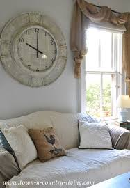 sharing my wall clock makeover at live creatively inspired town