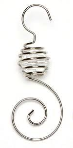 silver shaped decorative ornament hangers hooks by inge glas