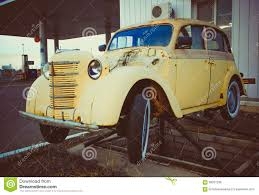 volkswagen yellow car vehicle retro yellow volkswagen beetle vintage car in a street stock photo