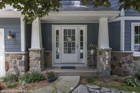 inviting elegant entry on blue house with stone accents and
