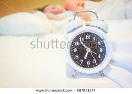 close on bed alarm clock woman stock photo 687831283 shutterstock