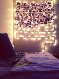 my wall in my room christmas lights photographs and clothespins