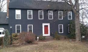navy blue check red door check white trim check black shutters